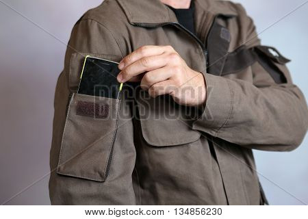 Specialized men's clothing with pocket for instruments and devices