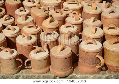 Mugs with a lid made of birch bark in the outside shop