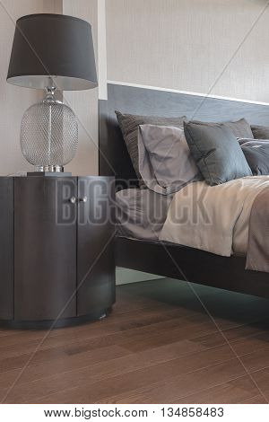 Pillows On Bed And Luxury Black Lamp Style On Wooden Table Side In Bedroom