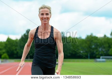 Healthy Fit Young Woman Running On A Track