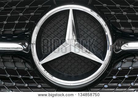 TURIN, ITALY - JUNE 13, 2015: Closeup of a Mercedes Benz logo