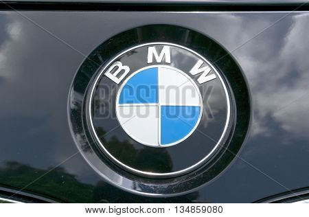 TURIN, ITALY - JUNE 13, 2015: A BMW logo on a black car body