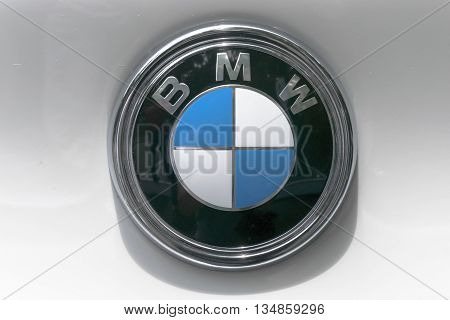 TURIN, ITALY - JUNE 13, 2015: A BMW logo on a white car body