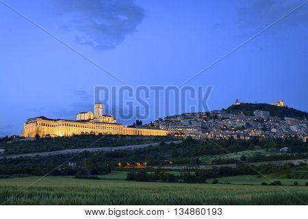 Illuminated Cityscape Assisi Basilica And Monastery