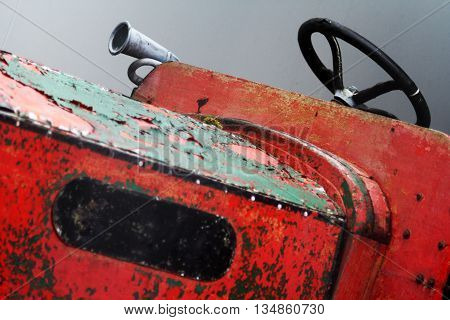 Old fashioned Rustic Tractor with steering wheel and horn