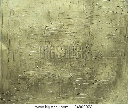 Painted canvas golden texture, gold paint on paper, gold brush stroke closeup