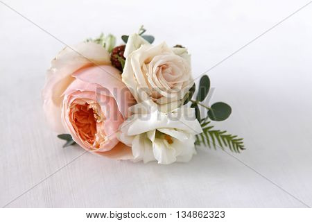 Image of a creatively designed boutonniere close up