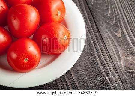 Plum Tomatoes On Wooden Rustic Background