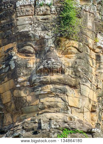 Temple detail at Angkor Thom showing a rock carved face
