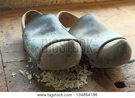 Old Dutch Style Wooden Clogs In The Workshop Of A Shoemaker