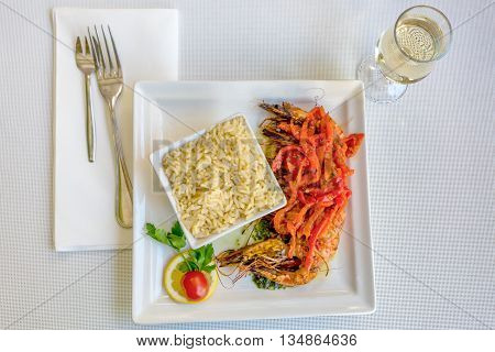 Table served with fried rice, shrimps and wine