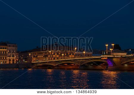 Beautiful panorama of Palace Embankment from river in St. Petersburg at night