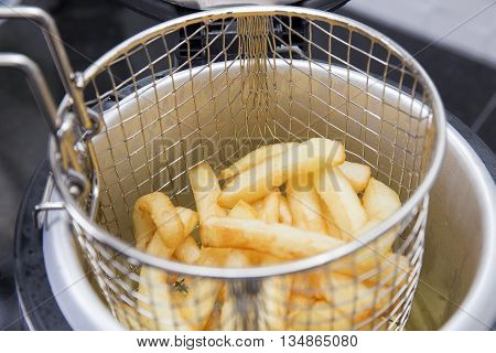 Closed up French Fried in the basket after cooking