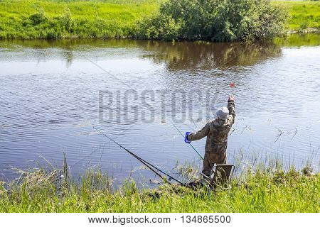 The river Kargat Novosibirsk oblast Siberia Russia - June 12 2016: fisherman lure fish in the river