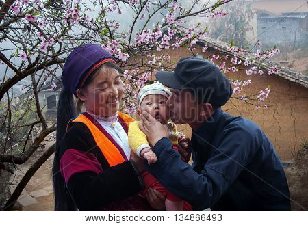 HA GIANG, VIETNAM, February 16, 2016 the couple ethnic Hmong, Ha Giang mountainous region. Happy young children