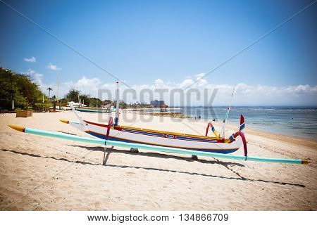 Traditional Balinese boat on a Sanur beach in Bali, Indonesia
