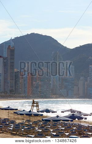 Benidorm sunrise with hammocks and parasol umbrellas with skyline background