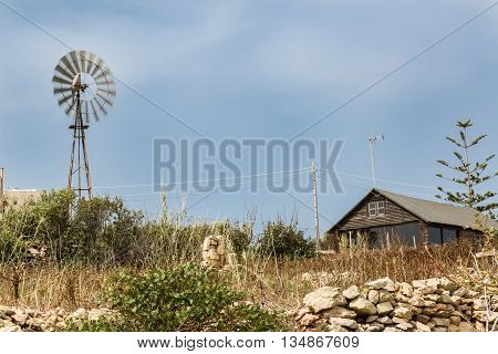 Simple Dwelling With A Wind Turbine