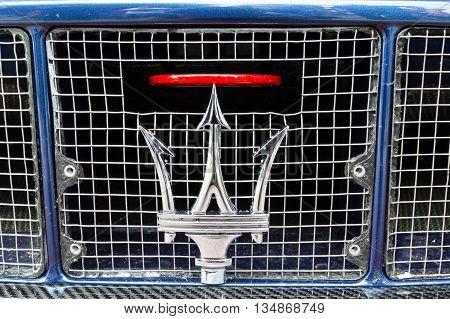 TURIN, ITALY - JUNE 13, 2015: Maserati logo on the grill of a MC12 model