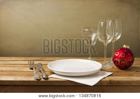 Christmas table arrangement with plate and glass