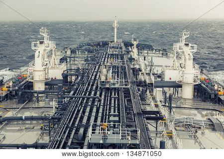 Crude oil tanker deck in the sea - vintage style.