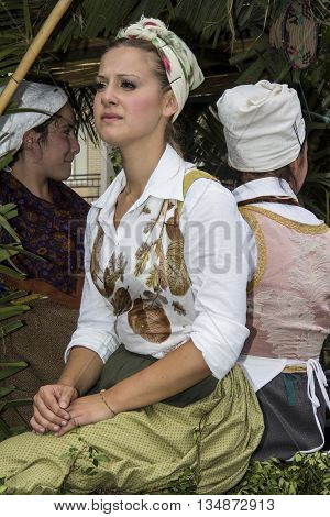 QUARTU S.E., ITALY - September 15, 2013: Wine Festival in honor of the celebration of St. Helena - Sardinia - portrait of a beautiful girl sitting in a chariot