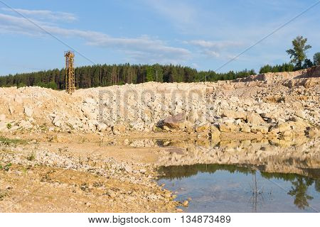 on the top of limestone quarry with blue sky