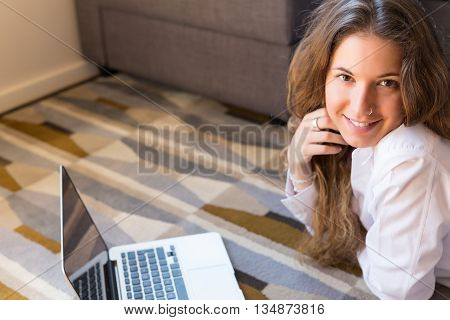 Beautiful woman relaxing with a computer at home