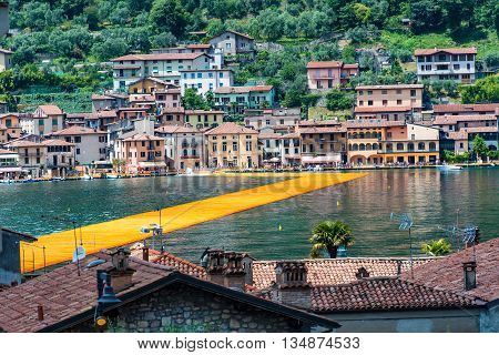 The Floating Piers. The Artist Christo Walkway On Lake Iseo