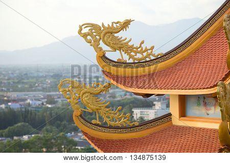 PHAN THIET, VIETNAM - DECEMBER 24, 2015: Fabulous bird on the roof of a Buddhist pagoda Buu Son, Religious landmark of the city Phan Thiet, Vietnam