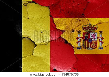 Flags Of Belgium And Spain Painted On Cracked Wall