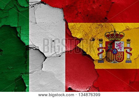 Flags Of Italy And Spain Painted On Cracked Wall