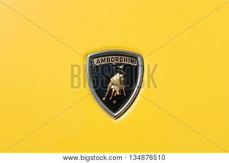 TURIN, ITALY - JUNE 9, 2016: Old Lamborghini logo on a yellow Miura car model