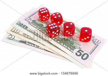 Red dices thrown down on dollar banknotes; isolated on white background