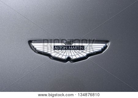 TURIN, ITALY - JUNE 9, 2016: Aston Martin logo on a grey car body