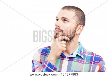 Thinking man looks up with hand on the face, isolated on white background