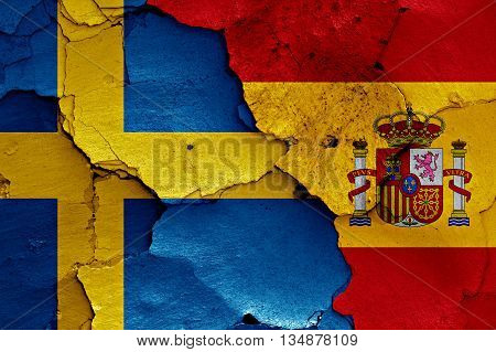 Flags Of Sweden And Spain Painted On Cracked Wall