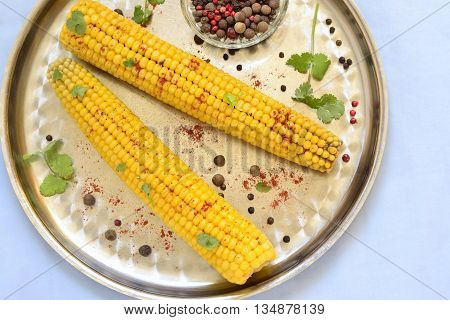 Boiled sweet corn with spices, top view
