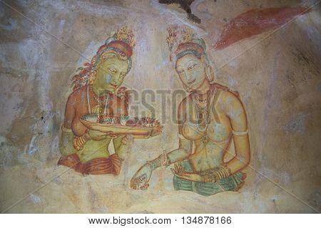 SIGIRIYA, SRI LANKA - MARCH 16, 2015: Old fresco on the wall of the mountain-palace of Sigiriya. Historical landmark of the city Sigiriya, Sri Lanka
