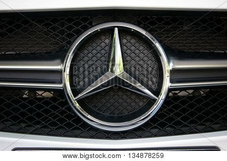TURIN, ITALY - JUNE 9, 2016: Closeup of a Mercedes Benz logo on a AMG car model