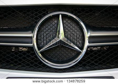 TURIN, ITALY - JUNE 9, 2016: Closeup of a Mercedes Benz logo on a AMG car model
