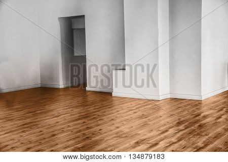 View of empty unfurnished room with parquet and white walls