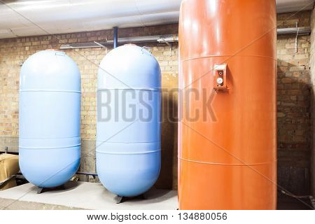 in the basement there are three major expansion boilers