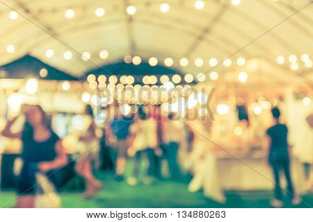 blur image street night maket festival blurred background with vintage tone