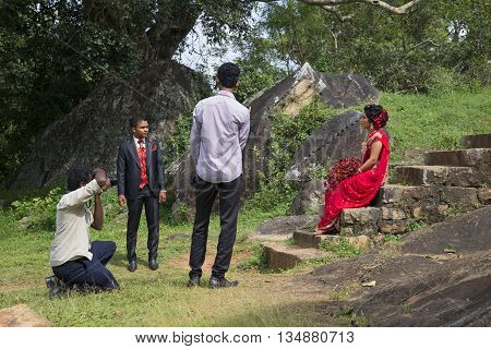 ANURADHAPURA SRI LANKA - MARCH 13, 2015: Wedding photoshoot takes place on the ruins of Vessagiri. The old part of the city of Anuradhapura, Sri Lanka