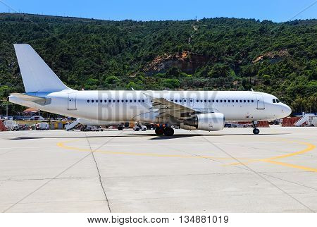 aircraft was taxiing to runway at the airport of Rhodes sunny day