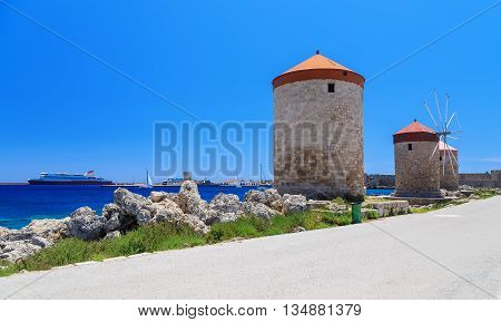 Rhodes mills on background of the sea bay and the port sunny day