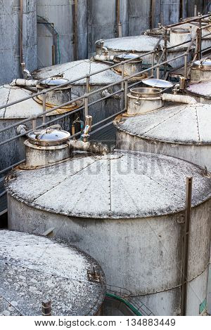 Large wine metal industrial vats containers in the factory