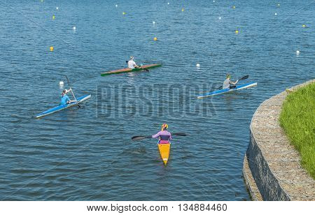 A group of young people practicing Canoeing at the rowing channel in Moscow.
