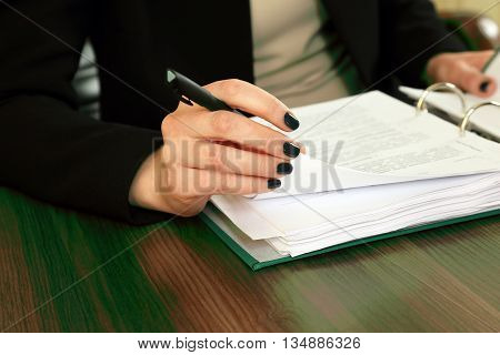 hand of business woman with document viewing it